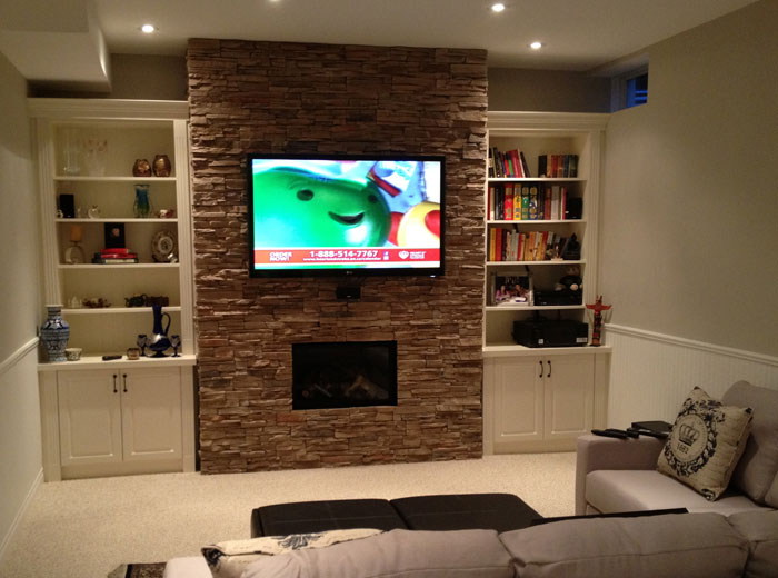 Custom wall unit with stoning around fireplace